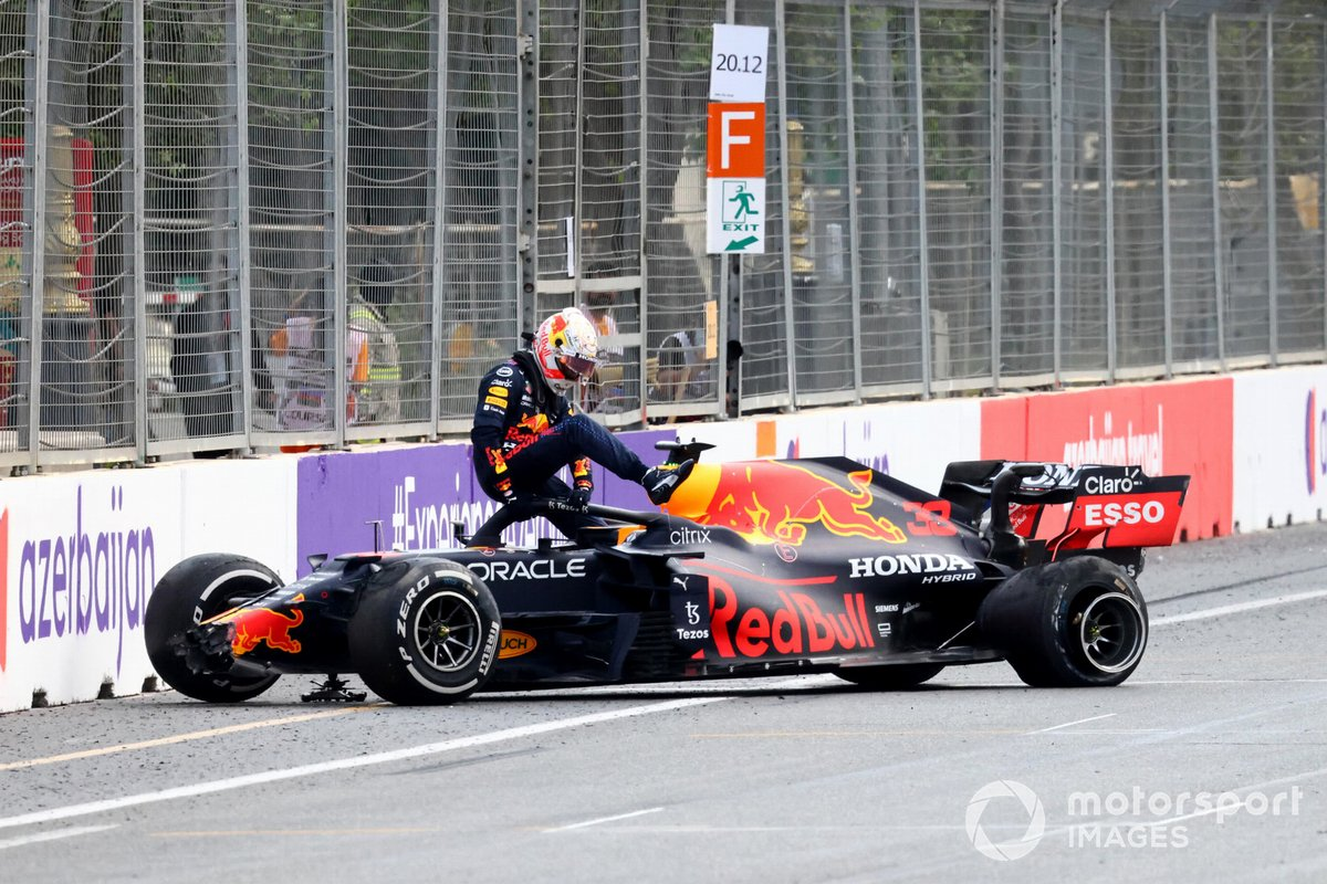 Max Verstappen, Red Bull Racing, climbs out of his car after crashing out from the lead